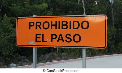 Prohibido el Paso. - Road sign that says Prohibido el Paso,...