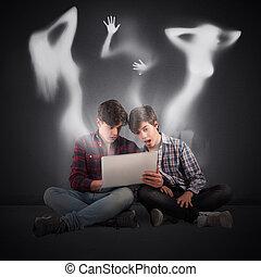 Boys look a tablet with female shadows