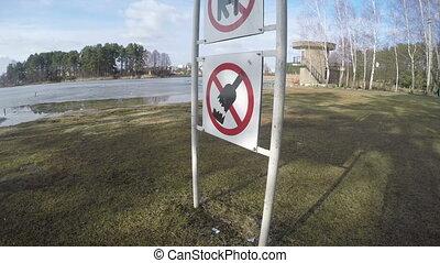 """prohibiting signs - """"Prohibiting warning signs near lake. No..."""
