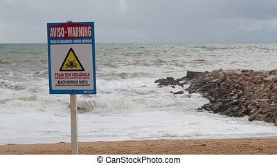 Prohibition sign for swimming on the beach during a storm. Portugal