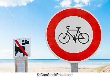 prohibits bikes sign and prohibits dogs sign