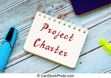 Project Charter sign on the sheet.