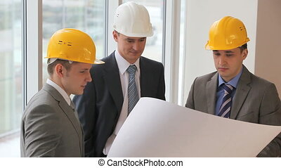 Project discussion - Three businessmen or engineers in...