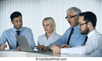 Project Group - Close up of business team of four discussing...