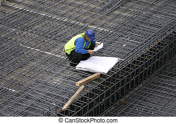 Project Manager reading the site plans - The site foreman...