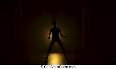 projecteurs, studio., mince, bodysuit, gracieux, obscurité, jaune, silhouette, théâtral, ballerine, noir, sous, flexible, danse