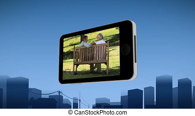 projection, couple, smartphone, personne agee