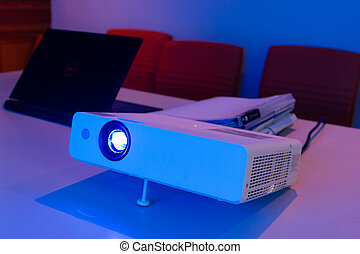 projector connected to Laptop for presentation in a meeting room