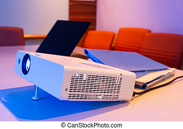 projector connected to Laptopon for presentation in a meeting room