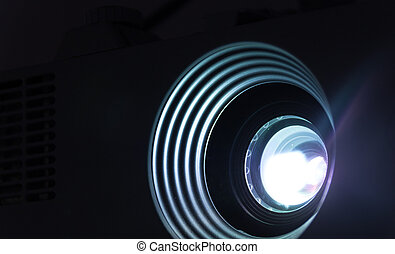 Projector lens photograph - Photograph of a lighted ...