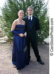 Prom - Beautiful young woman and handsome young man prepare...