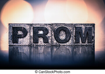 """The word """"PROM"""" written in vintage ink stained letterpress type."""
