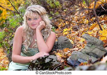 prom girl outdoors - young teen blonde girl in a prom dress...