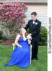 Prom Girl Seated Looking Up at Date