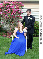 Prom Girl Seated Smiling at Date