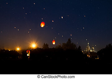 Prom on the Champ de Mars, flying lanterns against the...