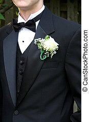 Prom Tux & Boutonniere - Closeup of the torso of a teen boy...