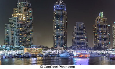 Promenade and canal in Dubai Marina timelapse at night, UAE.