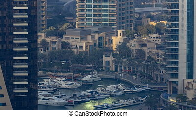 Promenade and canal in Dubai Marina with luxury skyscrapers...