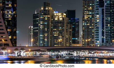 Promenade in Dubai Marina timelapse at night, UAE.