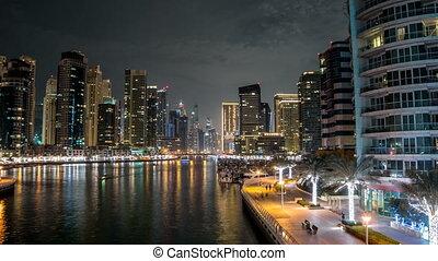 Promenade in Dubai Marina timelapse hyperlapse at night, UAE.