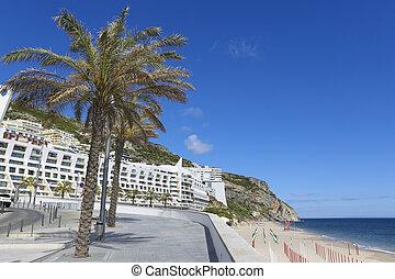 Promenade near the beach and the Atlantic coast of Sesimbra, Portugal.