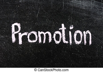 Promotion handwritten with white chalk on a blackboard