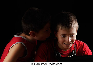 Prompt - Boy whispering brother's ear while they sitting at...