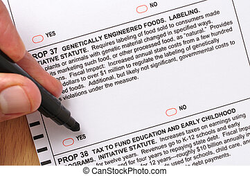 Prop 37 on ballot - Closeup of man about to mark vote for...
