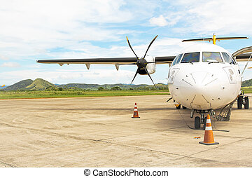 Prop Plane on Tarmac - Small propeller plane on tarmac, used...