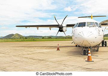 Prop Plane on Tarmac - Small propeller plane on tarmac, used...