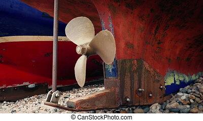 Small fishing boat propeller rotating shot