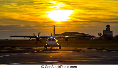 Propeller plane at sunset