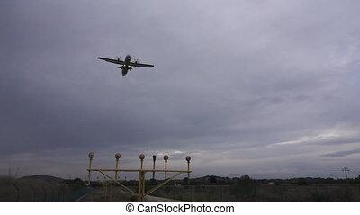 Propeller plane landing in super slow motion - Bottom view...