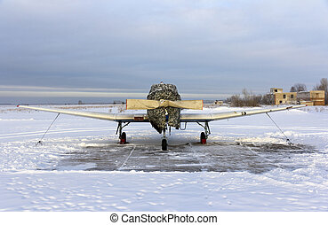 Propeller plane parking at the airport in winter