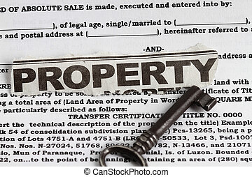 Property abstract for deed of sale with a vintage key in the...