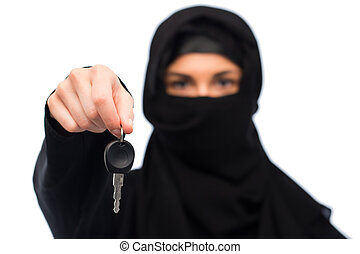 muslim woman in hijab with car key over white - property and...
