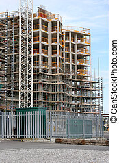 Property Boom - New tall building under construction with ...