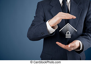 Property security and insurance concept. Protecting gesture of man and symbol of house with padlock.
