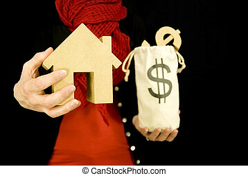 property purchase, woman holding golden house and a bag of money