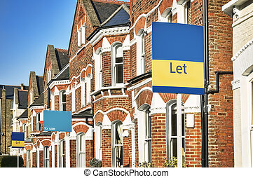 """Typical English home with a """"Let"""" and """"For Sale"""" sign"""