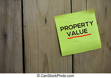 Property Value text on sticky notes with wooden background