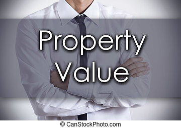 Property Value - Young businessman with text - business concept