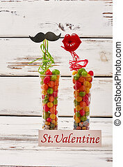 Props on Valentine's Day. Card near vases with candies....