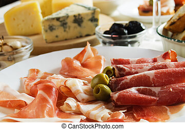 Prosciutto, italian cured ham with green olives