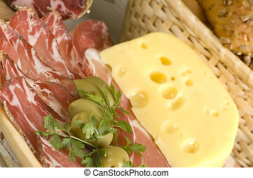 prosciutto, olives, cheese and bread close up