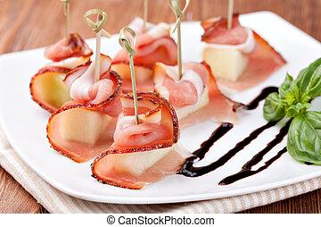 Prosciutto on a white plate