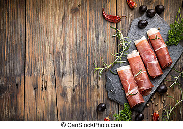 Top view of sliced prosciutto with space for your text