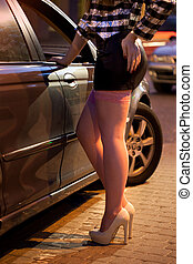 Prostitute leaning against car - Prostitute in pink...