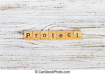 protéger, mot, sur, bloc, concept., protéger, mot, fait, à, blocs bois, table